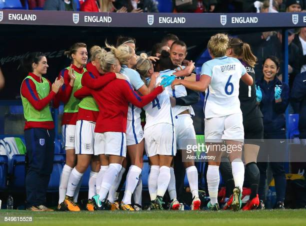 Nikita Parris of England celebrates with Mark Sampson the manager of England after scoring the opening goal during the FIFA Women's World Cup...
