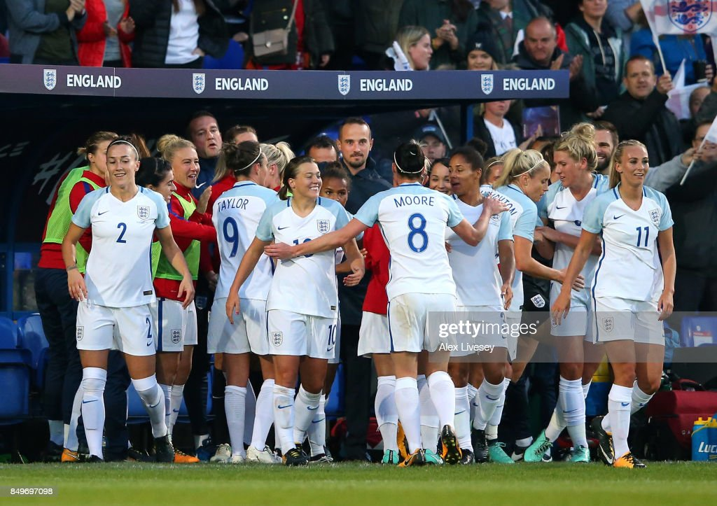 Nikita Parris of England celebrates with Mark Sampson the manager of England after scoring the opening goal during the FIFA Women's World Cup Qualifier between England and Russia at Prenton Park on September 19, 2017 in Birkenhead, England.