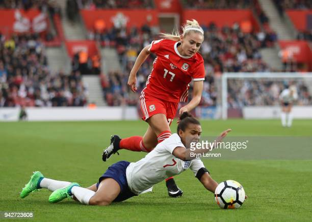Nikita Parris of England is challenged by Charlotte Estcourt of Wales during the Women's World Cup Qualifier match between England and Wales at St...