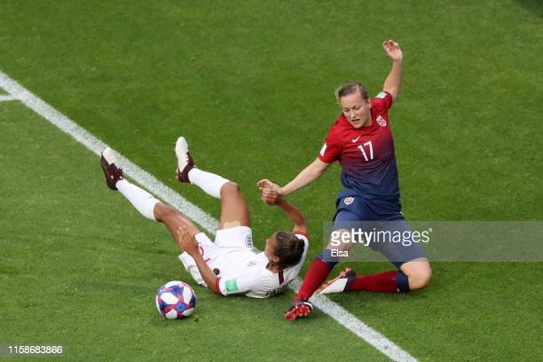 Nikita Parris of England is challenged by Kristine Minde of Norway during the 2019 FIFA Women's World Cup France Quarter Final match between Norway...