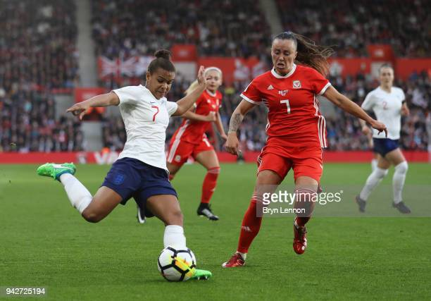 Nikita Parris of England is challenged by Natasha Harding of Wales during the Women's World Cup Qualifier match between England and Wales at St...