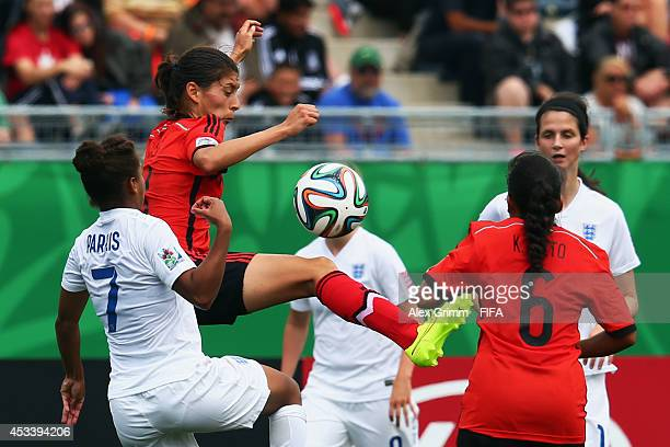 Nikita Parris of England is challenged by Paulina Solis of Mexico during the FIFA U20 Women's World Cup Canada 2014 group C match between England and...