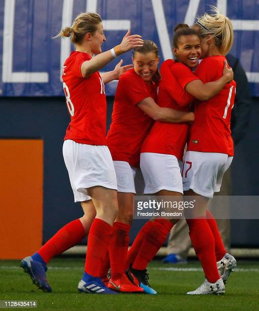 Nikita Parris of England is congratulated by teammate Rachel Daley and Izzy Christiansen after scoring a goal against the United States during the...