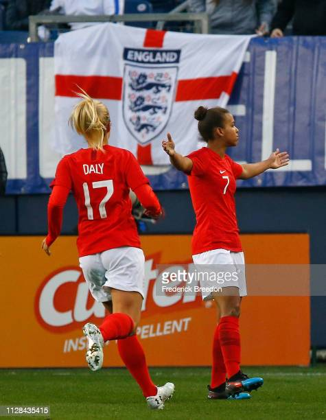 Nikita Parris of England is congratulated by teammate Rachel Daley after scoring a goal against the United States during the second half of the 2019...