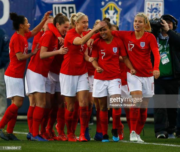 Nikita Parris of England is congratulated by teammates Rachel Daley and Steph Houghton after scoring a goal against the United States during the...