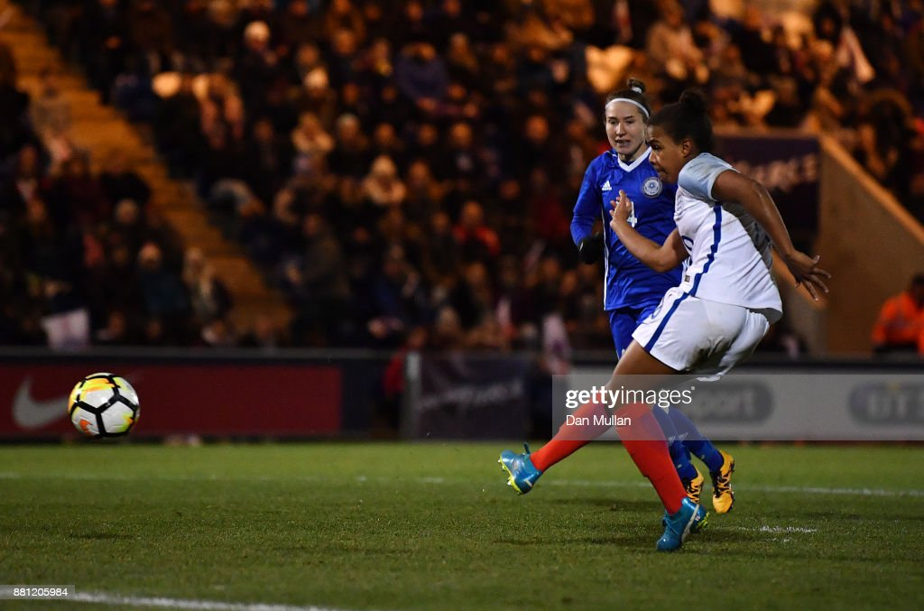 Nikita Parris of England scores her side's fourth goal during the FIFA Women's World Cup Qualifier between England and Kazakhstan at Weston Homes Community Stadium on November 28, 2017 in Colchester, England.