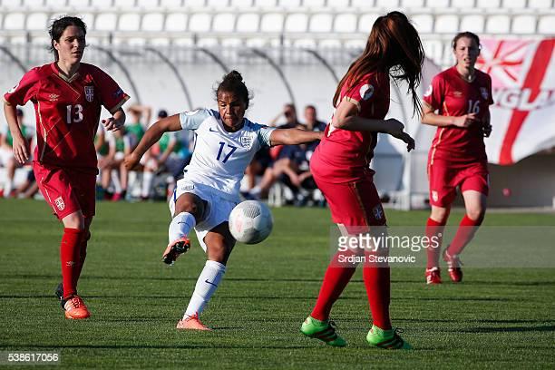 Nikita Parris of England scores past Marija Ilic and Marija Jonovic of Serbia during the UEFA Women's European Championship Qualifier match between...
