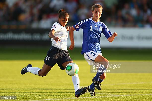 Nikita Parris of England U19 women prepares to shoot as Tiia Peltonen of Finland U19 women closes in during the UEFA Women's U19 SemiFinal match...