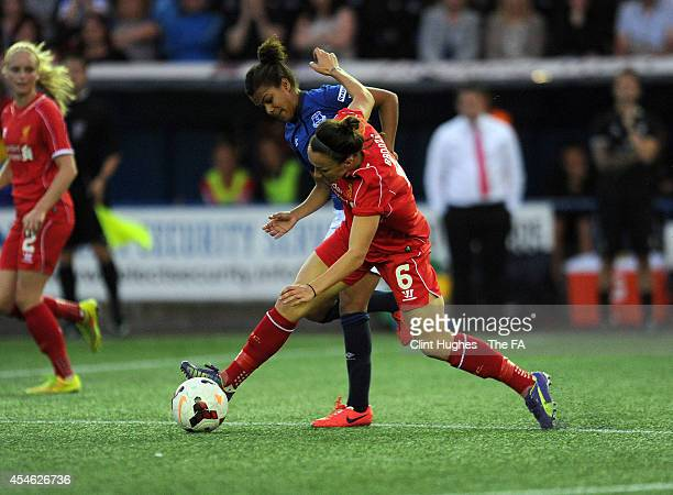 Nikita Parris of Everton Ladies FC and Lucy Bronze of Liverpool Ladies FC battle for the ball during the FA WSL 1 match between Everton Ladies FC and...
