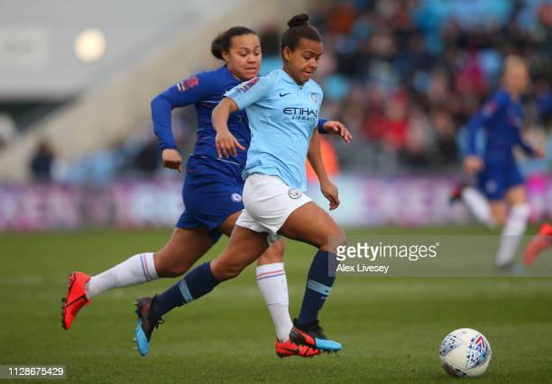 Nikita Parris of Manchester City Women beats Drew Spence of Chelsea Women during the FA WSL match between Manchester City Women and Chelsea Women at...
