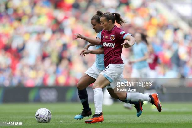 Nikita Parris of Manchester City Women is challenged by Ria Percival of West Ham United Ladies during the Women's FA Cup Final match between...