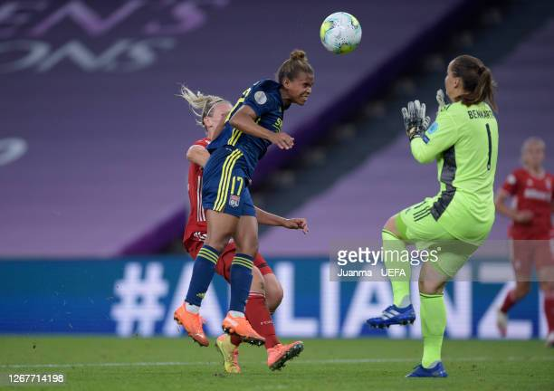 Nikita Parris of Olympique Lyon scores her team's first goal past Laura Benkarth of FC Bayern Munich during the UEFA Women's Champions League Quarter...