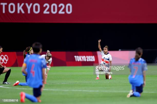 Nikita Parris of Team Great Britain takes a knee in support of the Black Lives Matter movement prior to the Women's First Round Group E match between...