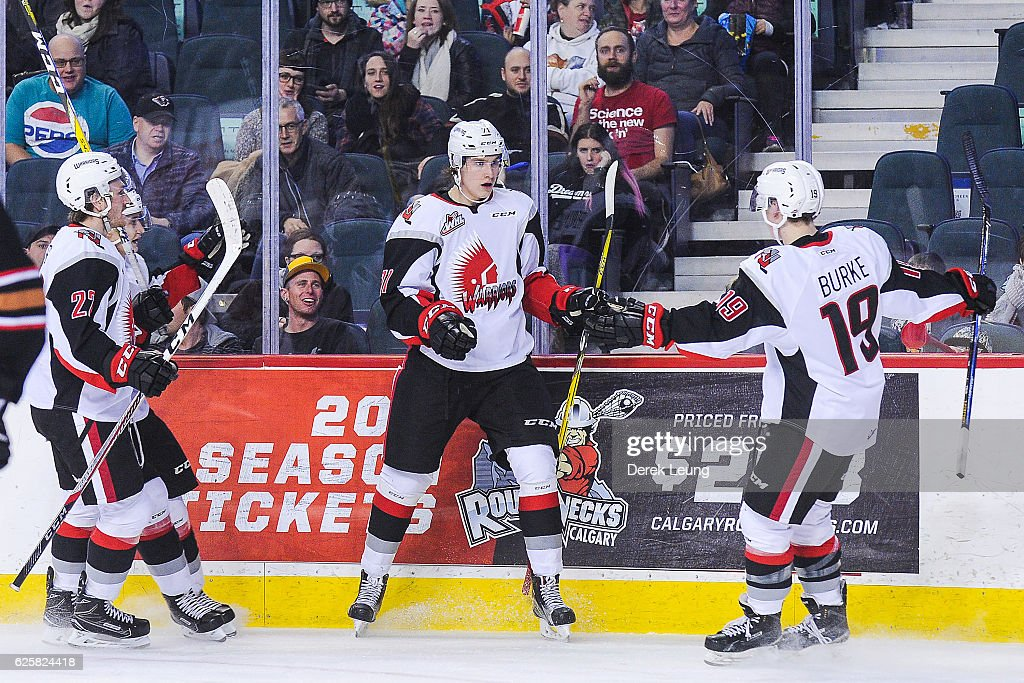 Nikita Popugaev #71 (C) of the Moose Jaw Warriors scores against Cody Porter #31 of the Calgary Hitmen during a WHL game at Scotiabank Saddledome on November 25, 2016 in Calgary, Alberta, Canada.