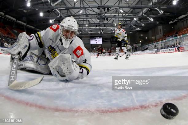 Nikita Quapp, goaltender of Krefeld Pinguine watches the puck after Pekka Jormakka of Wolfsburg scores the 5th goal during the Deutsche Eishockey...