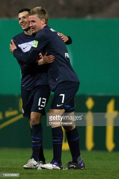 Nikita Rukavytsya celebrates the third goal with Maik Franz of Berlin during the second round DFB Cup match between RotWeiss Essen and Hertha BSC...