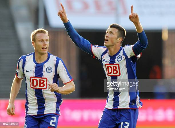 Nikita Rukavytsya of Berlin jubilates with team mate Christian Lell after scoring the second goal during the Second Bundesliga match between Hertha...