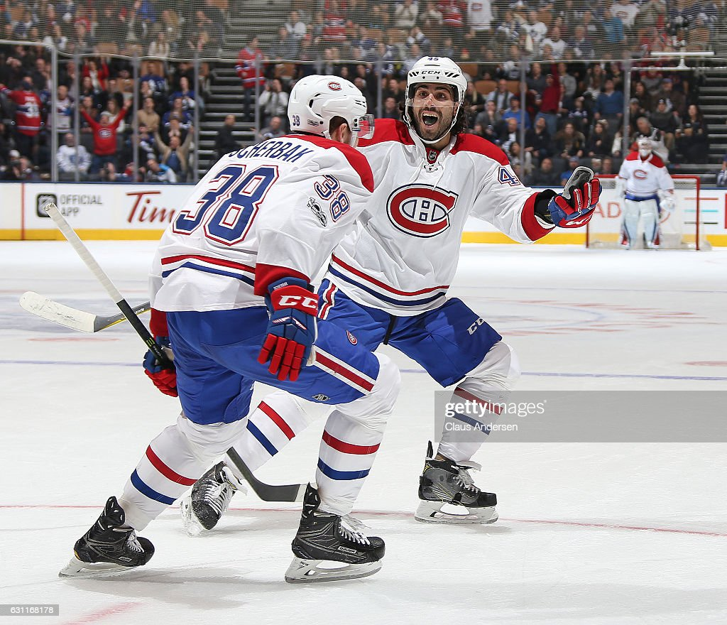 Nikita Scherbak #38 of the Montreal Canadiens celebrates his 1st NHL goal with teammate Mark Barberio #45 against the Toronto Maple Leafs during an NHL game at the Air Canada Centre on January 7, 2017 in Toronto,Ontario, Canada.