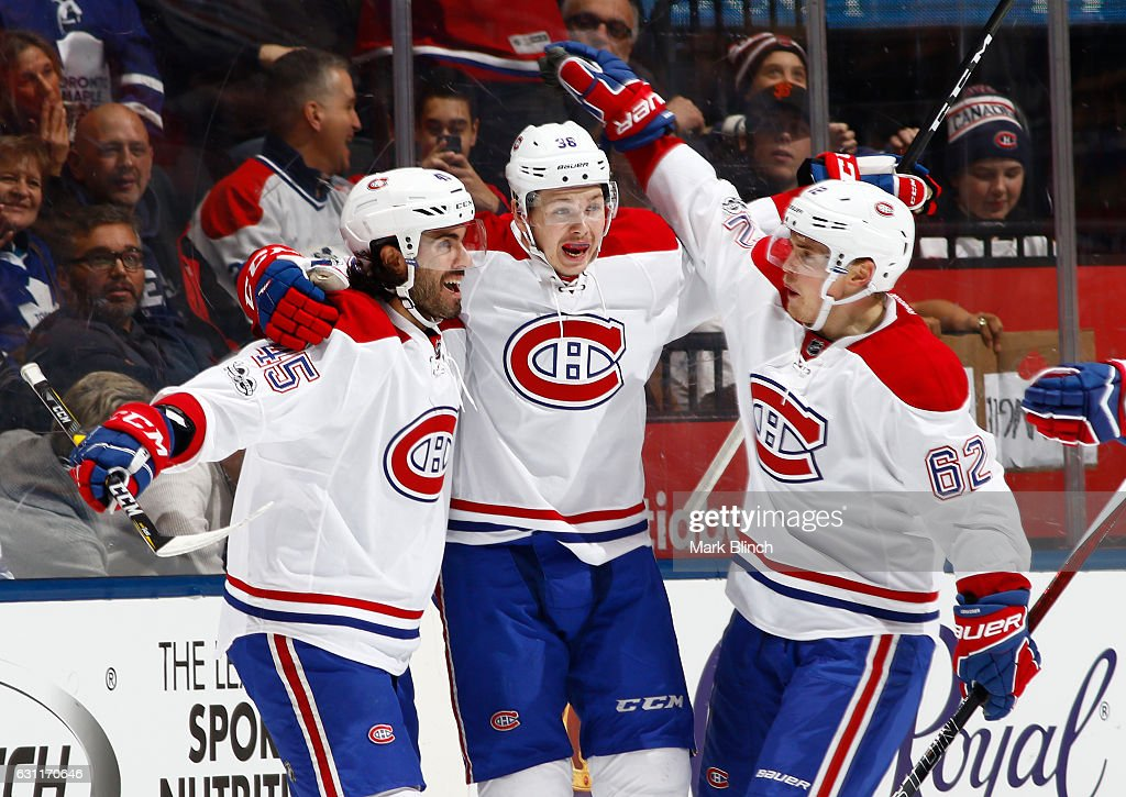 Nikita Scherbak #38 of the Montreal Canadiens celebrates his first NHL goal in his first NHL game against the Toronto Maple Leafs with teammates Mark Barberio and Artturi Lehkonen during the first period at the Air Canada Centre on January 7, 2017 in Toronto, Ontario, Canada.