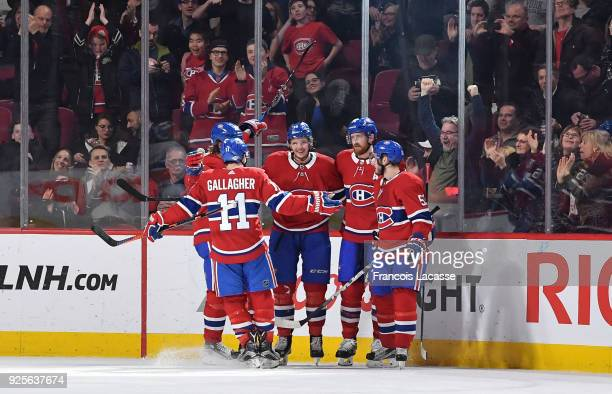Nikita Scherbak of the Montreal Canadiens celebrates with teammates after scoring a goal against the New York Islanders in the NHL game at the Bell...