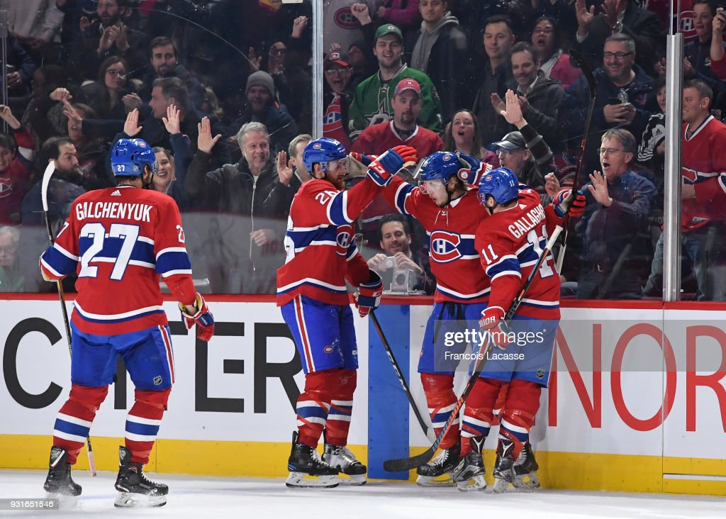 Nikita Scherbak #38 of the Montreal Canadiens celebrates with teammates after scoring a goal against the Dallas Stars in the NHL game at the Bell Centre on March 13, 2018 in Montreal, Quebec, Canada.