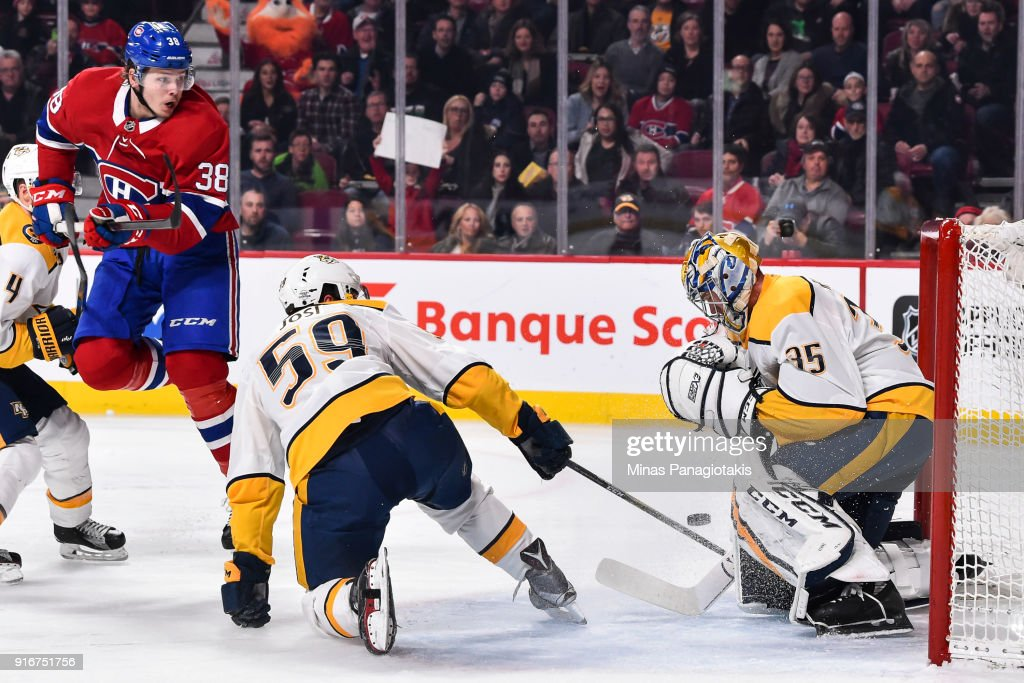 Nikita Scherbak #38 of the Montreal Canadiens jumps as he gets a shot on goaltender Pekka Rinne #35 of the Nashville Predators during the NHL game at the Bell Centre on February 10, 2018 in Montreal, Quebec, Canada.