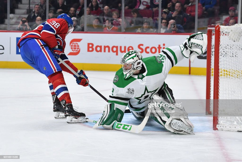 Nikita Scherbak #38 of the Montreal Canadiens scores a goal on goaltender Kari Lehtonen #32 of the Dallas Stars in the NHL game at the Bell Centre on March 13, 2018 in Montreal, Quebec, Canada.