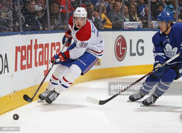 Nikita Scherbak of the Montreal Canadiens skates with the puck away from William Nylander of the Toronto Maple Leafs during an NHL game at the Air...