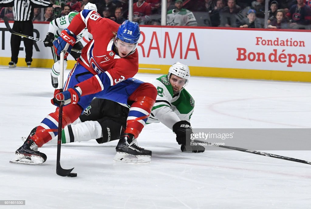 Nikita Scherbak #38 of the Montreal Canadiens skates with the puck under pressure from Dan Hamhuis #2 of the Dallas Stars in the NHL game at the Bell Centre on March 13, 2018 in Montreal, Quebec, Canada.