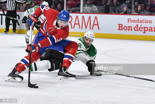 Nikita Scherbak of the Montreal Canadiens skates with the puck under pressure from Dan Hamhuis of the Dallas Stars in the NHL game at the Bell Centre...