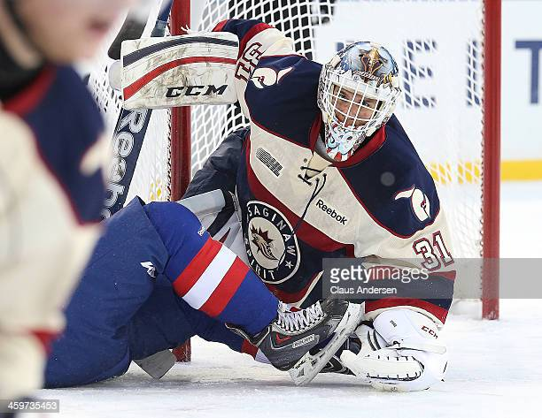 Nikita Serebryakov of the Saginaw Spirit looks for a rebound against the Windsor Spitfires in Game One of the OHL Winter Classic at Comerica Park on...