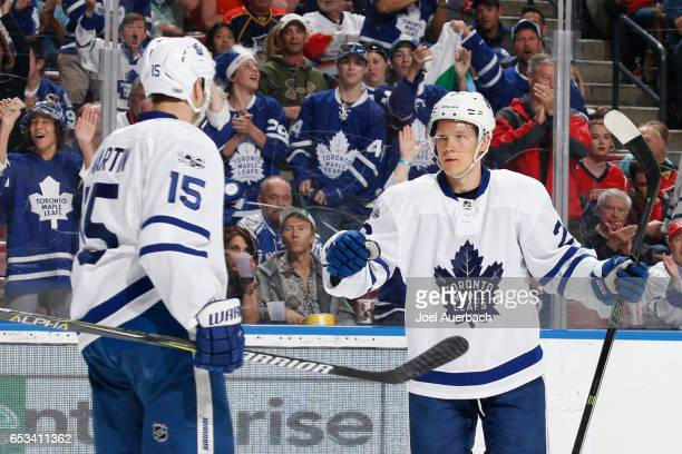 Nikita Soshnikov celebrates his second period goal with Matt Martin of the Toronto Maple Leafs against the Florida Panthers at the BBT Center on...