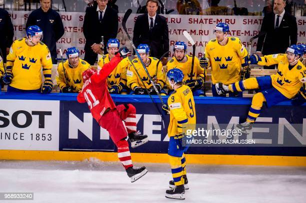 Nikita Soshnikov of Russia and Adrian Kempe of Sweden vie during the IIHF World Championship group A ice hockey match between Russia and Sweden in...
