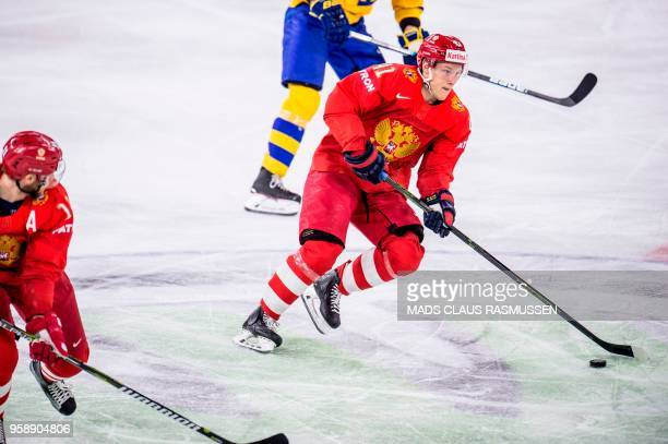 Nikita Soshnikov of Russia controls the puck during the group A match Russia v Sweden of the 2018 IIHF Ice Hockey World Championship at the Royal...