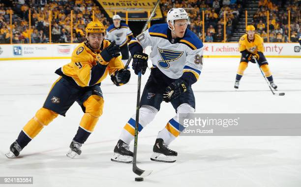 Nikita Soshnikov of the St Louis Blues skates against Filip Forsberg of the Nashville Predators during an NHL game at Bridgestone Arena on February...