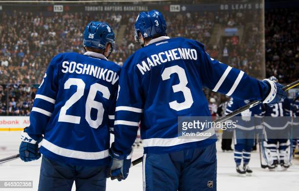 Nikita Soshnikov of the Toronto Maple Leafs and Alexey Marchenko talk during the third period at an NHL game against the New York Rangers at the Air...