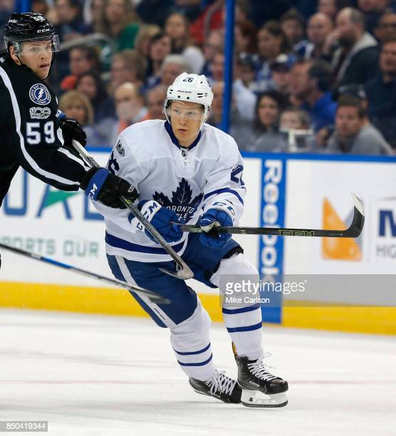 Nikita Soshnikov of the Toronto Maple Leafs avoids a check from Jake Dotchin of the Tampa Bay Lightning during the first period at the Amalie Arena...