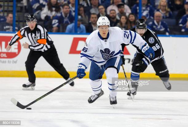 Nikita Soshnikov of the Toronto Maple Leafs brings the puck up against the Tampa Bay Lightning during the first period at the Amalie Arena on March...