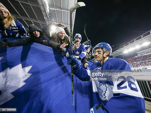 Nikita Soshnikov of the Toronto Maple Leafs greets fans after the Maple Leafs defeated the Red Wings in overtime at the 2017 Scotiabank NHL...
