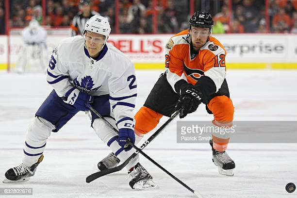 Nikita Soshnikov of the Toronto Maple Leafs is checked by Michael Raffl of the Philadelphia Flyers during the third period at Wells Fargo Center on...
