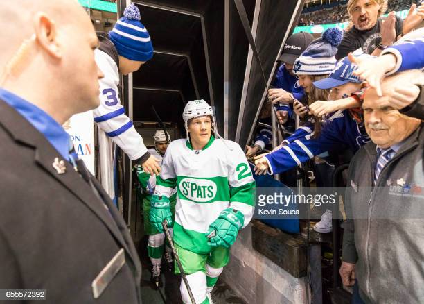 Nikita Soshnikov of the Toronto Maple Leafs is surrounded by fans prior at an NHL game against the Chicago Blackhawks at the Air Canada Centre on...