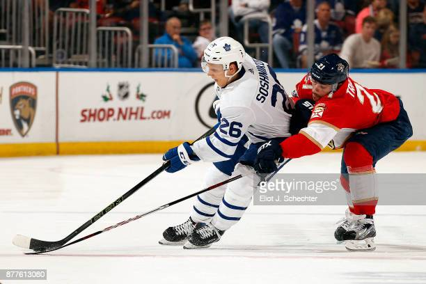 Nikita Soshnikov of the Toronto Maple Leafs skates with the puck against Vincent Trocheck of the Florida Panthers at the BBT Center on November 22...