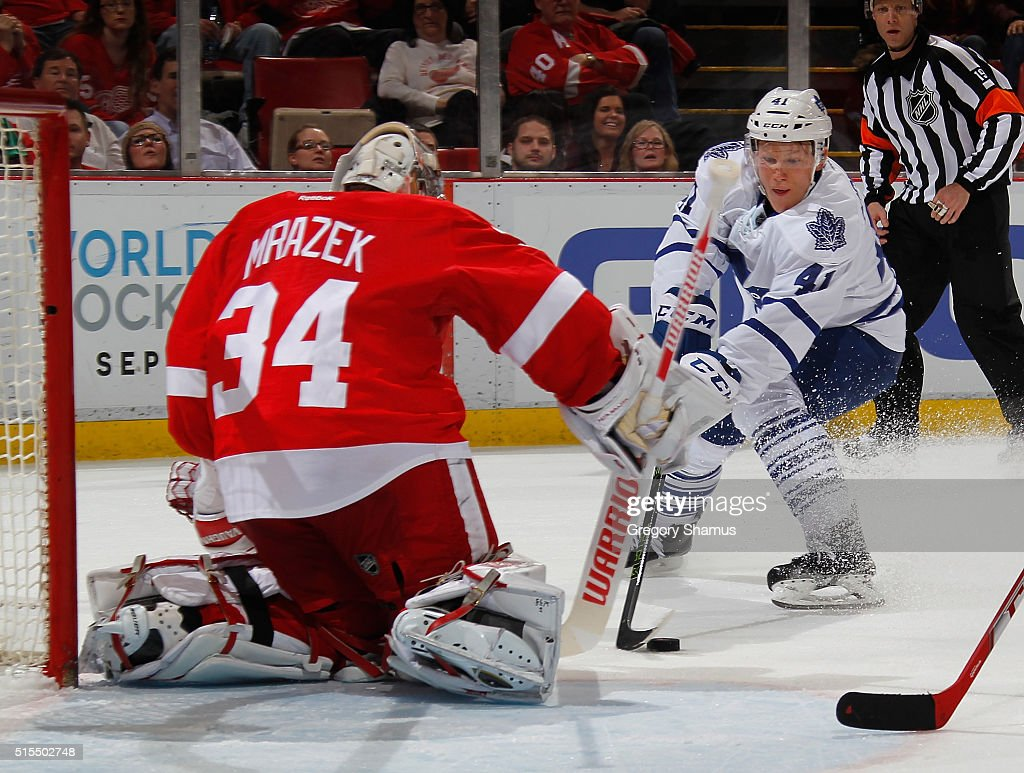 Nikita Soshnikov #41 of the Toronto Maple Leafs tries to get a shot off on Petr Mrazek #34 of the Detroit Red Wings during the third period at Joe Louis Arena on March 13, 2016 in Detroit, Michigan. Toronto won the game 1-0.