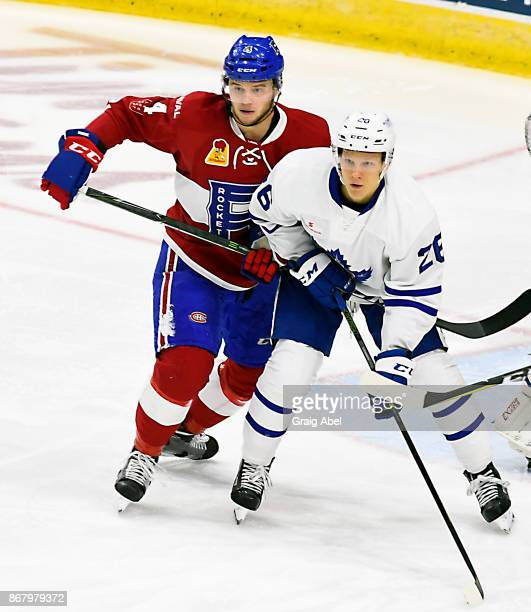 Nikita Soshnikov of the Toronto Marlies battles with Simon Bourque of the Laval Rocket during AHL game action on October 28 2017 at Ricoh Coliseum in...