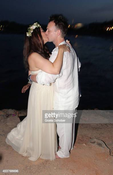 Nikita Stromberg and star chef Holger Stromberg kiss during their wedding on August 9 2014 in Ibiza Spain
