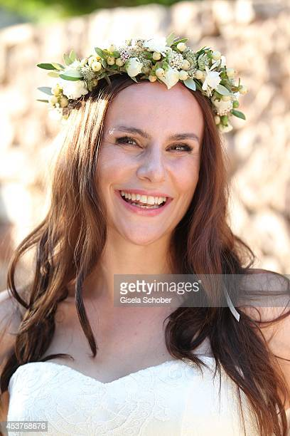 Nikita Stromberg poses during her wedding with star chef Holger Stromberg on August 9 2014 in Ibiza Spain