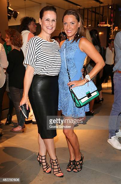 Nikita Stromberg Simone Ballack during the Emporio Armani Friends event at the Armani Caffe on July 29 2015 in Munich Germany