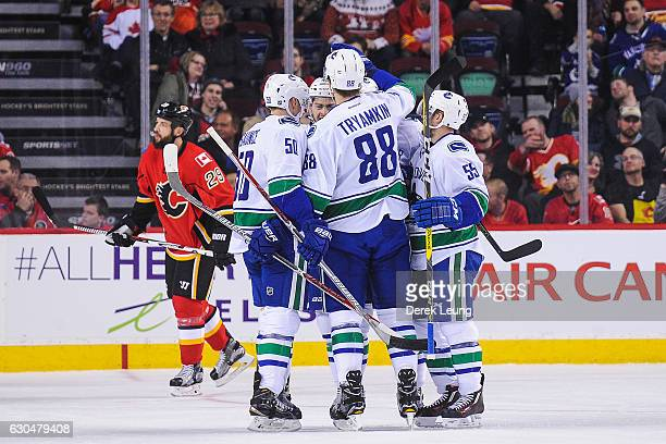 Nikita Tryamkin of the Vancouver Canucks celebrates with his teammates after scoring against the Calgary Flames during an NHL game at Scotiabank...