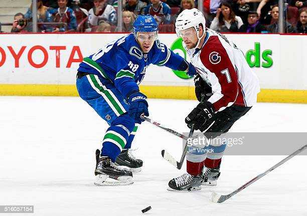 Nikita Tryamkin of the Vancouver Canucks defends against John Mitchell of the Colorado Avalanche during their NHL game at Rogers Arena March 16 2016...