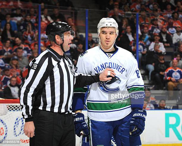 Nikita Tryamkin of the Vancouver Canucks exchanges words with an official during the game against the Edmonton Oilers on April 6 2016 at Rexall Place...